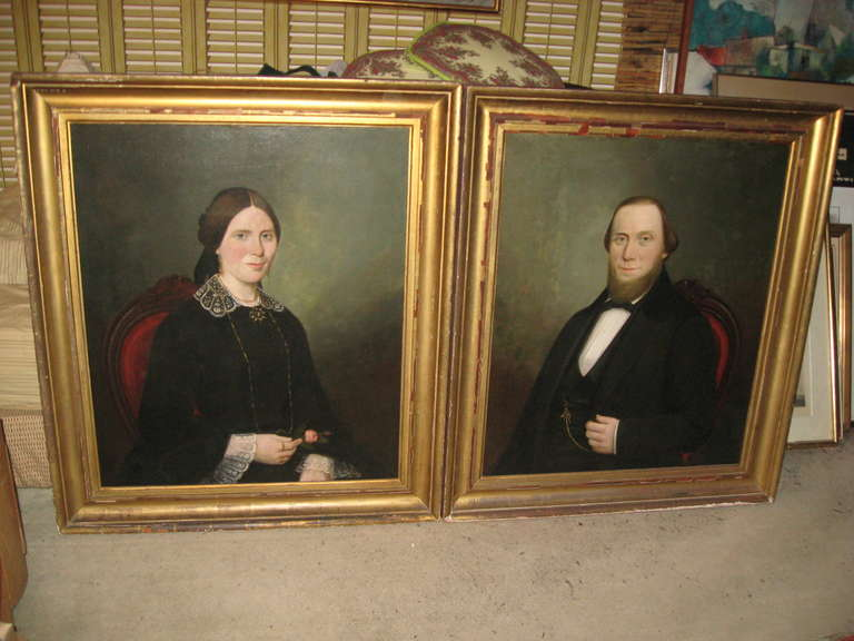 Pair of American, 19th century Sag Harbor portraits in original giltwood frames