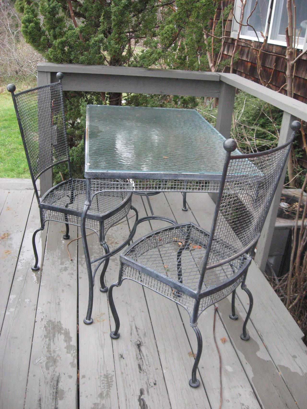 Mid century set of four rare high back Russell Woodard iron chairs. Table en suite available. . Pair of lounge chairs.