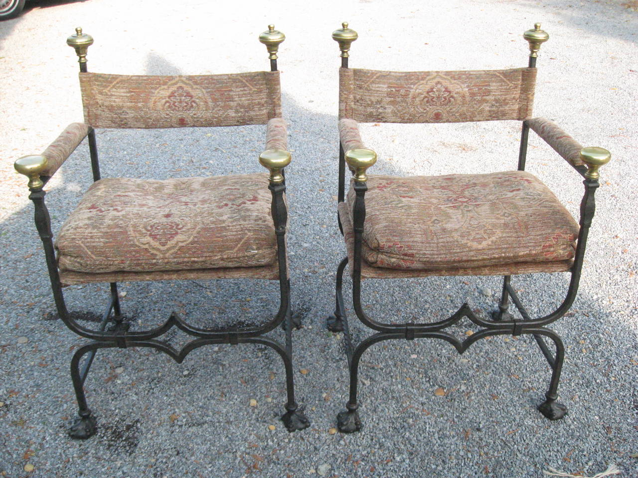 """Pair of 19th century Italian iron and bronze Savonarola chairs with paw feet and  separate loose cushions. Seat H first seat 17"""" with cushion 21"""" D 16"""" W 20"""" chair H 36"""" to bronze finial. Front arm H 28"""" to brass"""