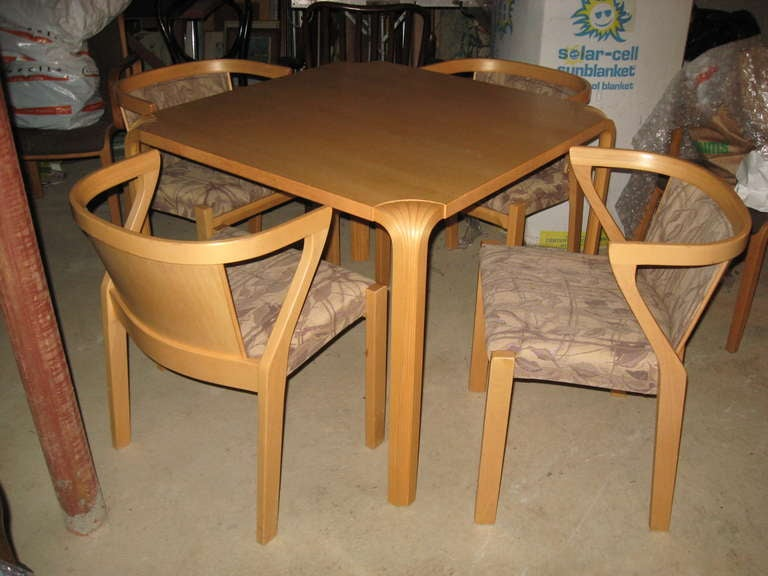 """Alvar Aalto """"Fan Leg"""" birchwood dining or game table and chairs manufactured by Artek of Finland."""