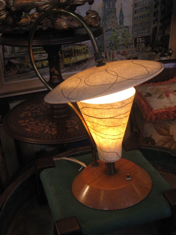 Midcentury lamp with resin shade on wood base.