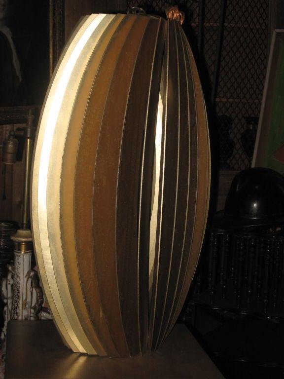 Modernistic brass color pendant chandelier.