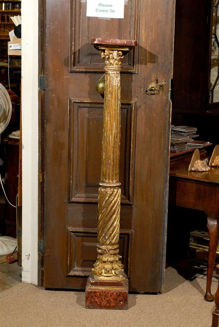 A pair of Neoclassical gilt-wood columns with painted top and base. 