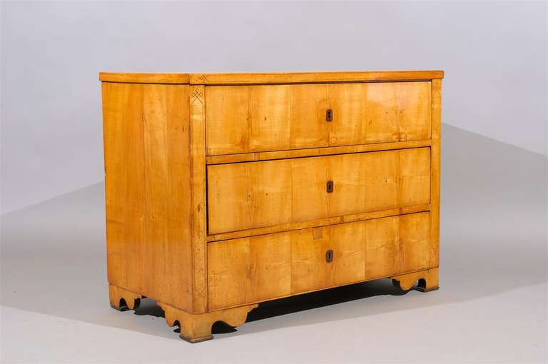 19th Century Biedermier Commode with Inlay, 3 sliding drawers and shaped feet.