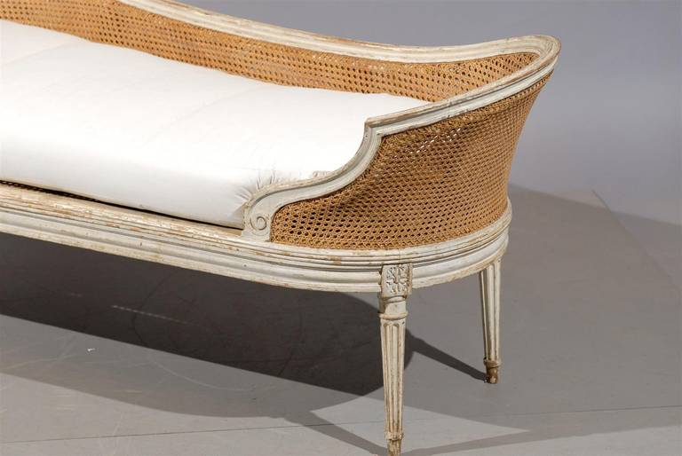 Louis xvi style painted and cane chaise lounge with loose for Chaise lounge atlanta