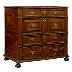 English Walnut Early 19th Century Five-Drawer Chest with Geometric Front