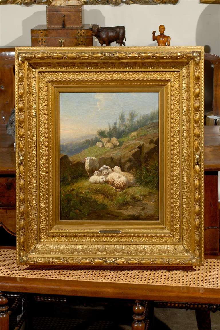 This exquisite Dutch vertical format oil on canvas painting from the mid-19th century depicts sheep in fields and is attributed to Karel van Contich. This is a beautifully serene scene: a flock of sheep, divided into several groups, is resting on