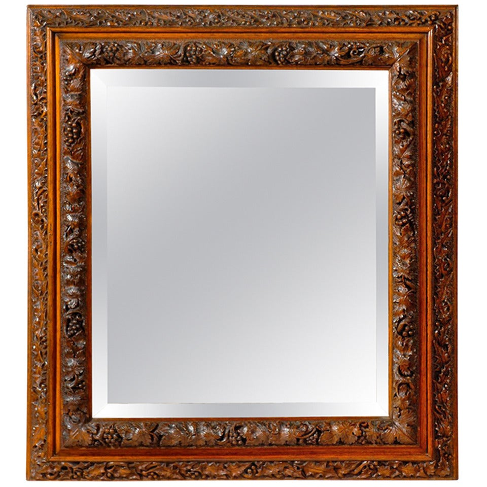English 1880s Rectangular Mirror with Bevelled Glass and Foliage Adorned Frame