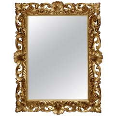 Italian Large Size Mirror with Carved Giltwood Frame from the Late 19th Century