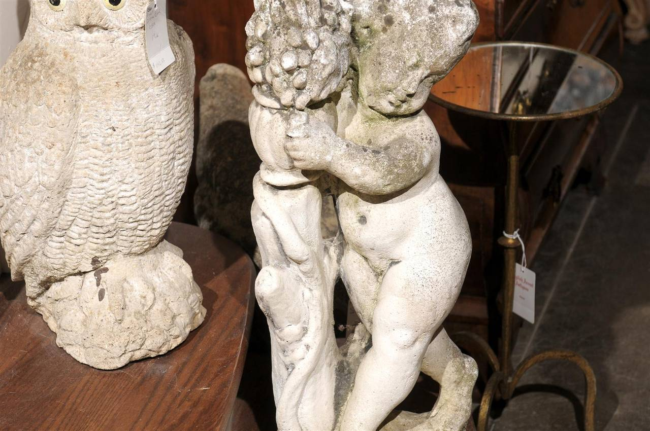 French Carved Stone Putti Sculpture with Grapes from the Mid 20th Century For Sale 3
