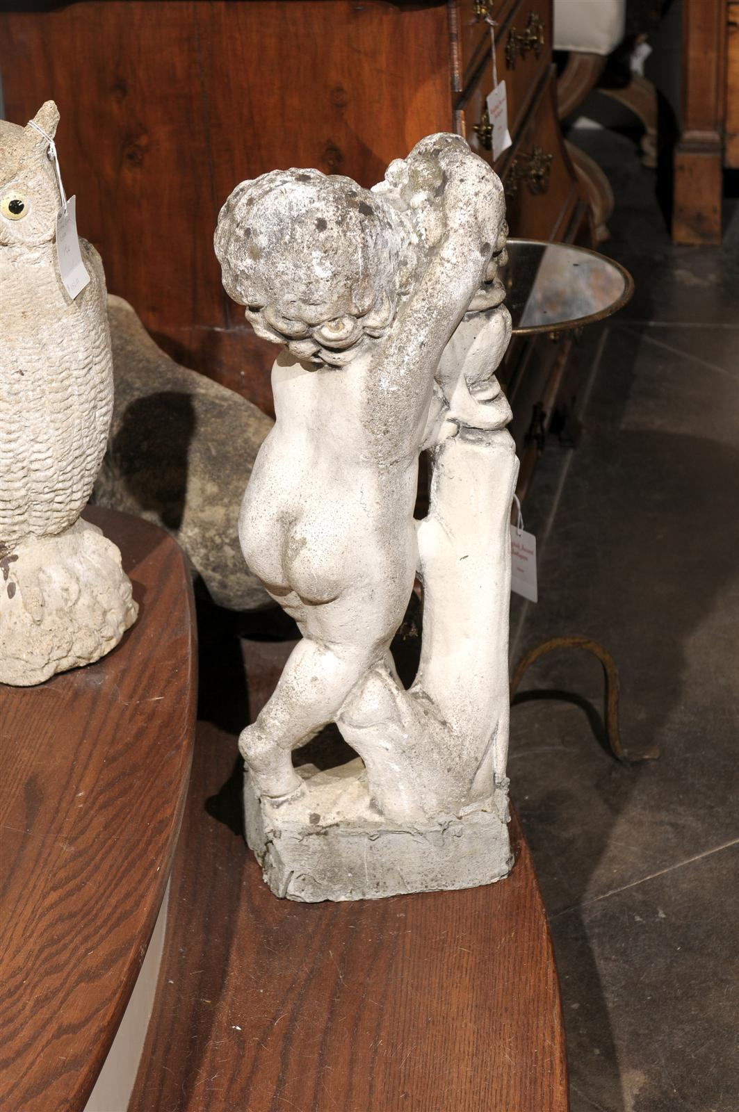 French Carved Stone Putti Sculpture with Grapes from the Mid 20th Century For Sale 1