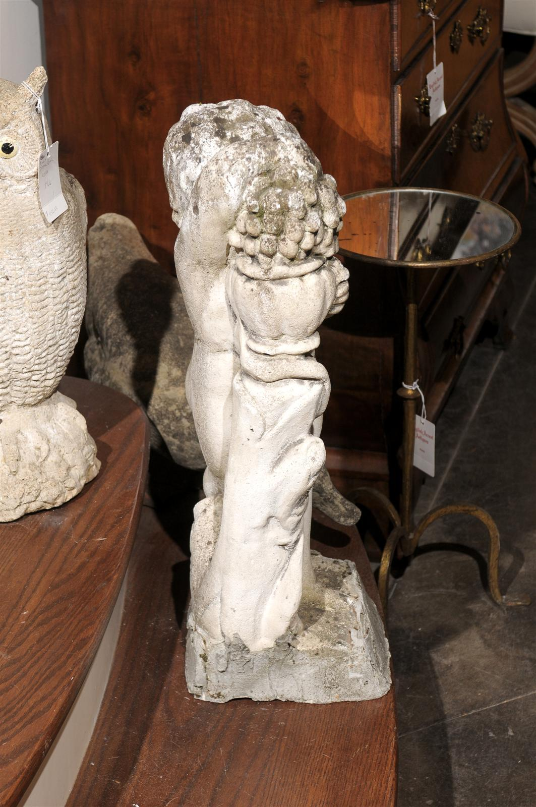 French Carved Stone Putti Sculpture with Grapes from the Mid 20th Century In Good Condition For Sale In Atlanta, GA