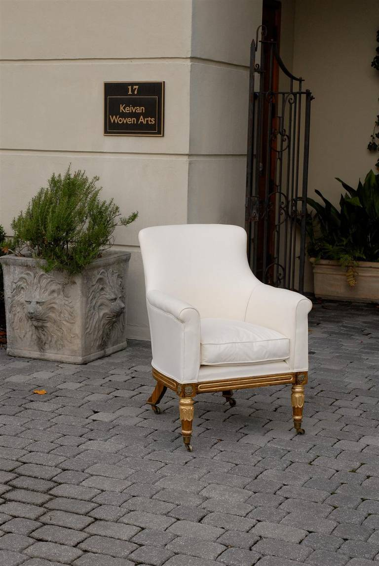 English Regency Upholstered Armchair with Painted and Gilt Wood Legs on Casters In Good Condition For Sale In Atlanta, GA