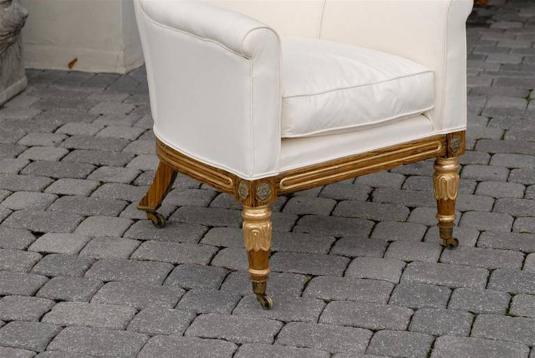 English Regency Upholstered Armchair with Painted and Gilt Wood Legs on Casters For Sale 6