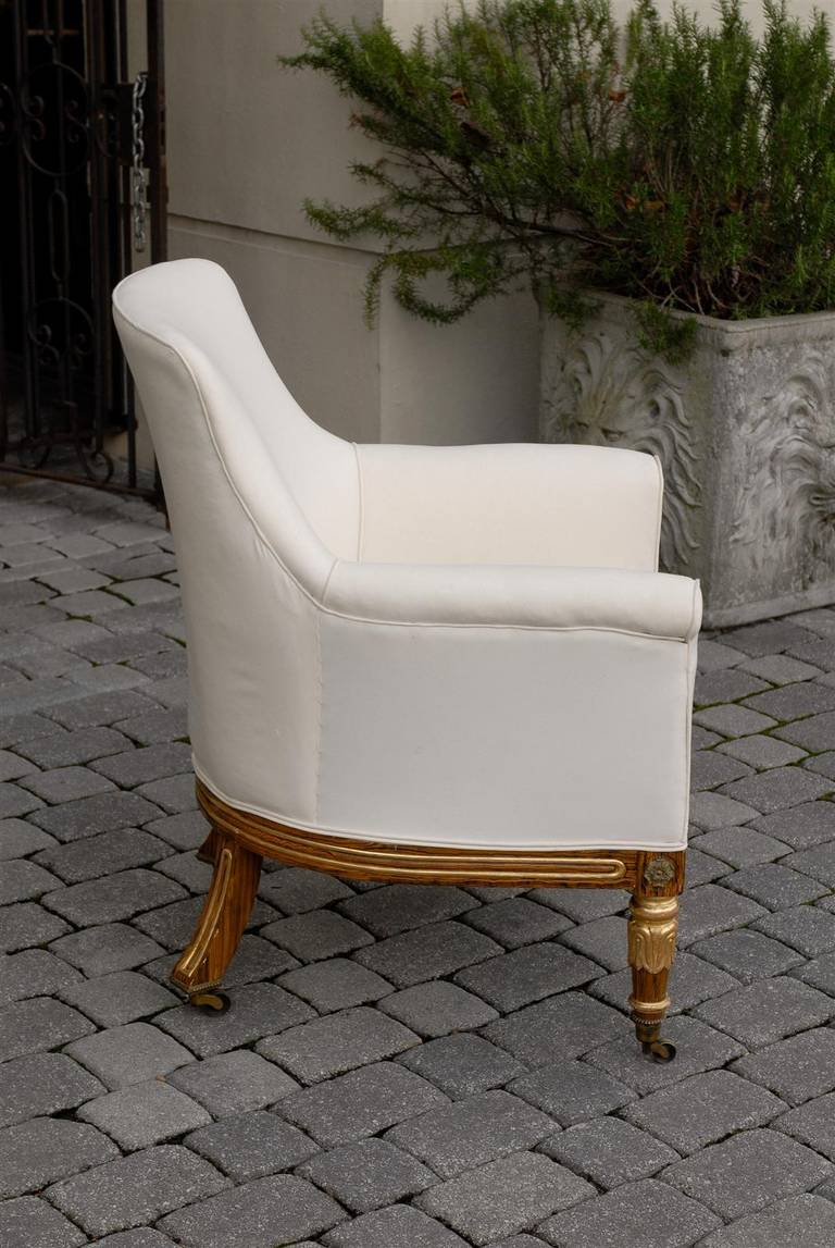19th Century English Regency Upholstered Armchair with Painted and Gilt Wood Legs on Casters For Sale