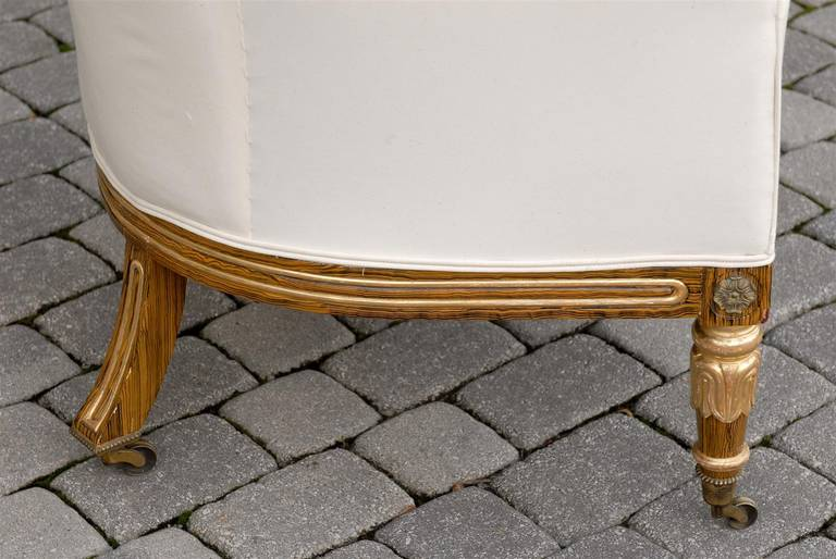 English Regency Upholstered Armchair with Painted and Gilt Wood Legs on Casters For Sale 1