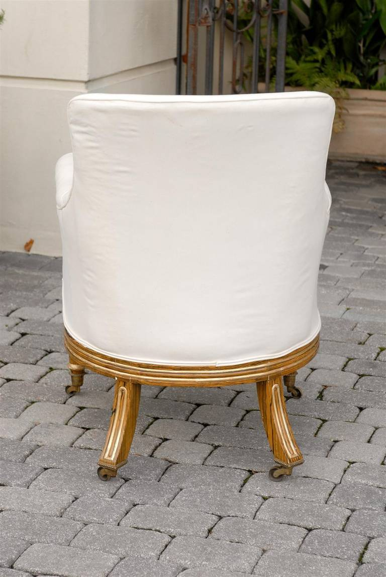 English Regency Upholstered Armchair with Painted and Gilt Wood Legs on Casters For Sale 3