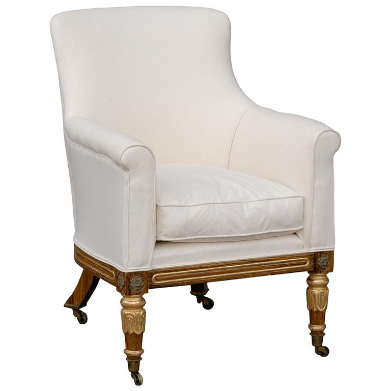 English Regency Upholstered Armchair with Painted and Gilt Wood Legs on Casters For Sale