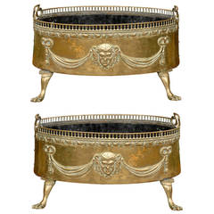 Pair of Dutch 1820s Jardinières with Repoussé Brass Décor and Paw Feet