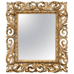 Italian Mid-19th Century Distressed Giltwood Mirror with Acanthus Leaves Motifs