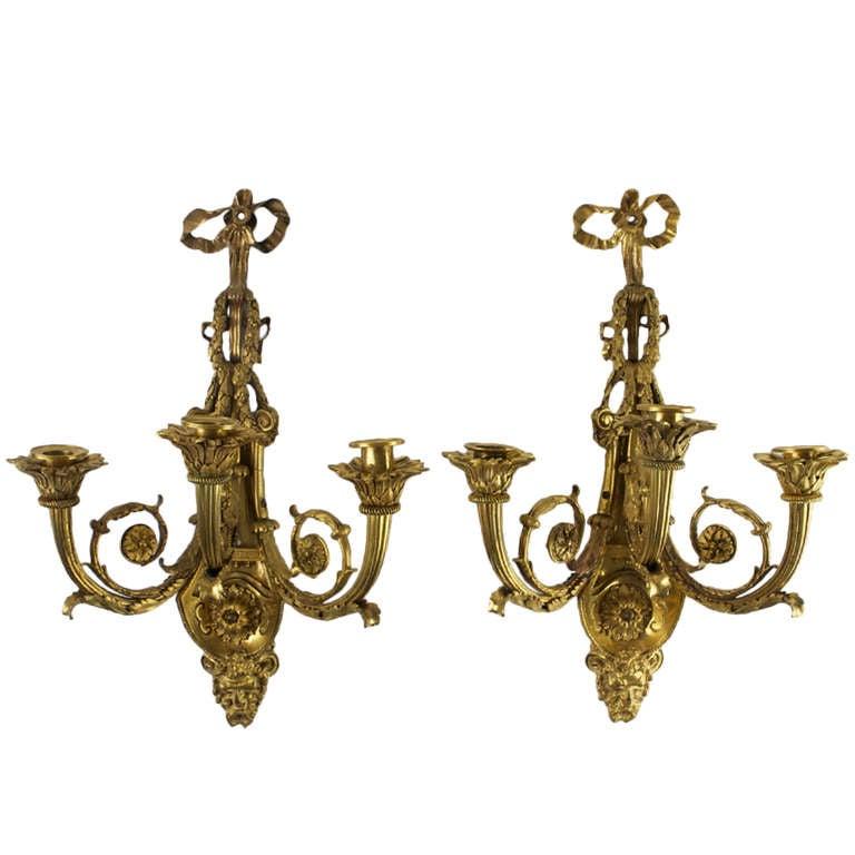 Rare Pair of Louis XVI Style Gilt Bronze Three-Light Sconces