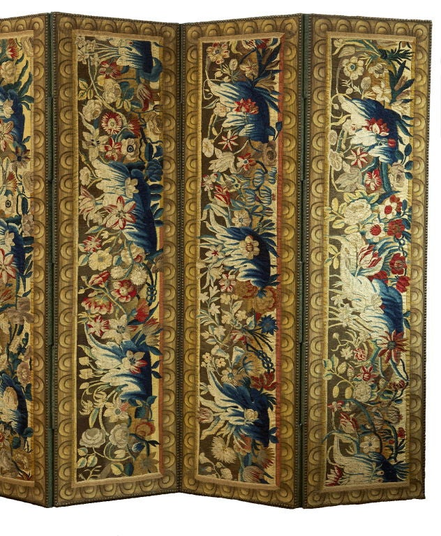 Each tapestry upholstered panel incorporating Flemish vertical tapestry fragments woven with foliate blossoms and sprays set in a later surround woven frame.