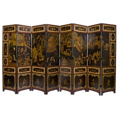 Chinese Black and Polychrome Lacquered Eight-Panel Screen