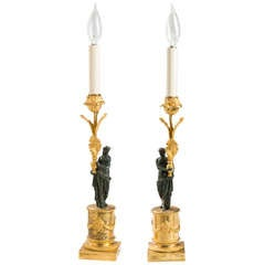 Pair of Directoire Ormolu and Patinated Bronze Figural Candlesticks