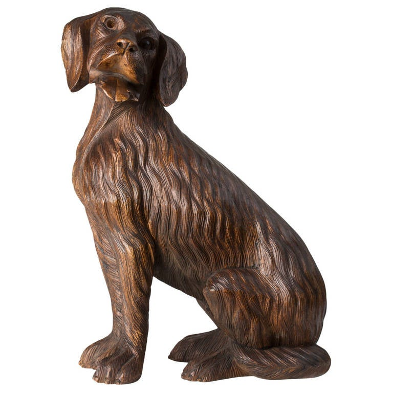 Large black forest wood carving of a seated dog at stdibs