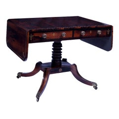 A Regency Brass Inlaid Rosewood Sofa Table