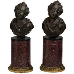 Pair of Italian Patinated Bronze Putti on Gilt Bronze-Mounted Porphyry Bases
