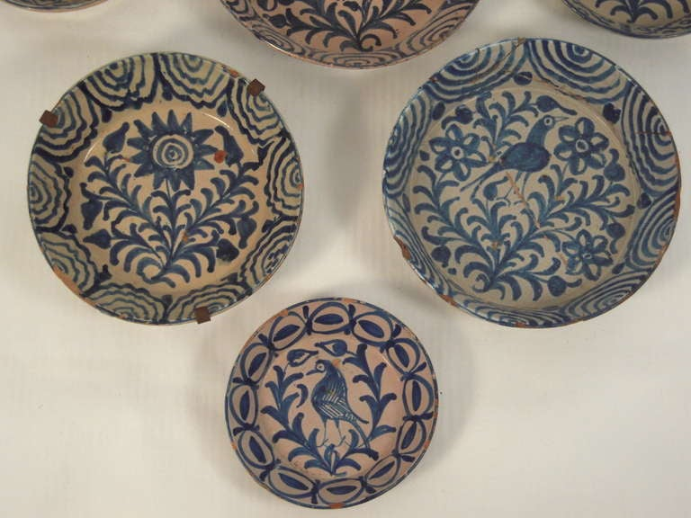 A Striking Collection Of 7 Spanish Blue And White Pottery