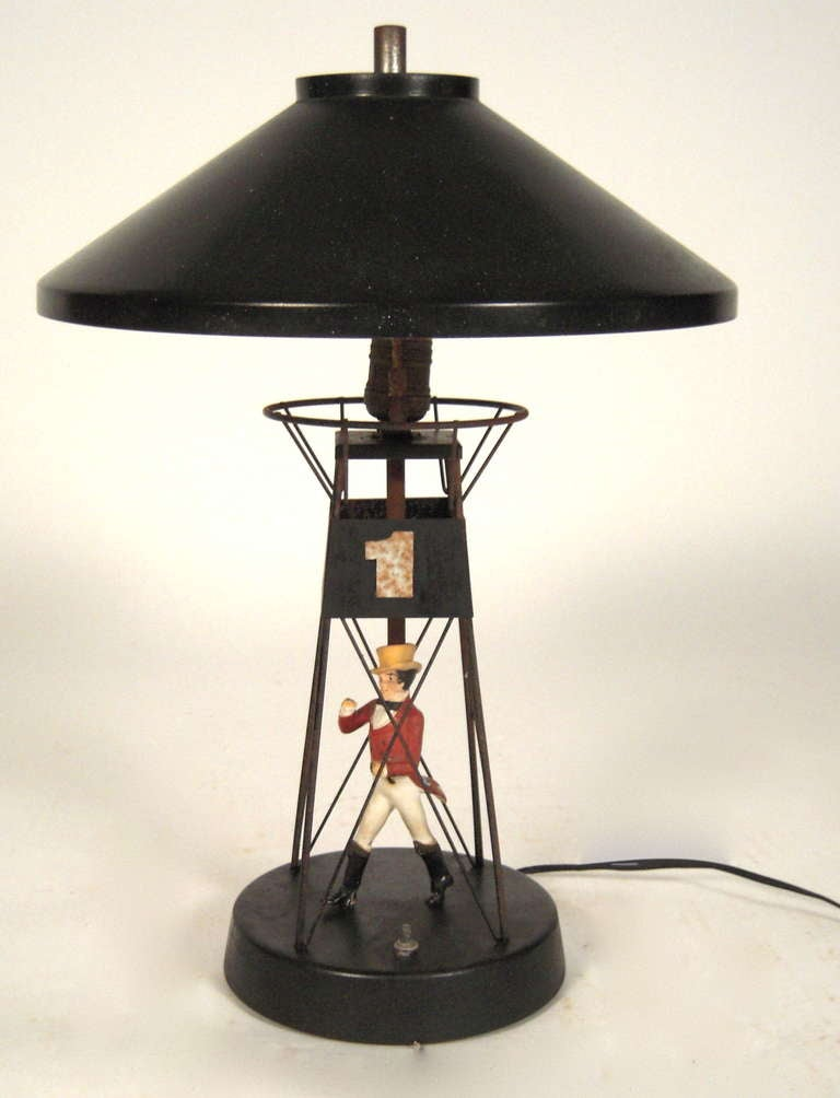 A 1960s Johnnie Walker buoy lamp in painted metal and plaster.