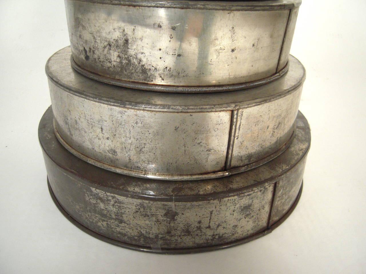 sculptural stack of old wedding cake tins at 1stdibs