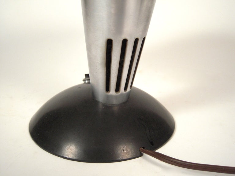 Executive Desk Lamp , Model No. 114, by Walter Dorwin Teague (1883-1960), and manufactured by the Polaroid Corporation, Cambridge, Massachusetts, circa 1939-1941, in bakelite and aluminum.  This iconic lamp is in major museum collections, including