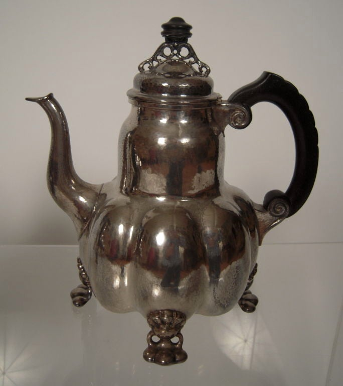 A fine quality hand wrought Arts and Crafts period silver and silver gilt tea and coffee service, made by the Bremen Guild of Handicraft (BWKS), likely for the Scandinavian market, with Baroque style lobed form coffee pot, tea pot, creamer and sugar