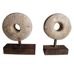 Two Carved and Mounted Mill Stones