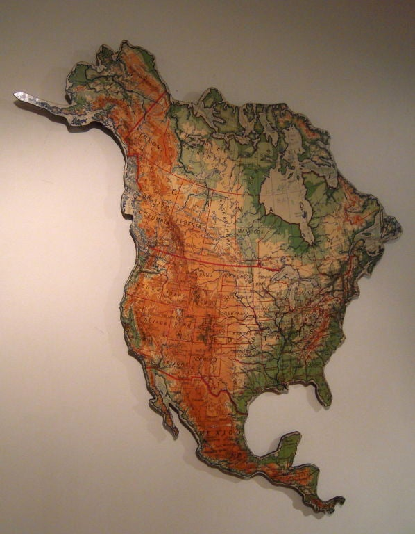 A vintage schoolroom map of North America newly mounted on heavy duty masonite with reinfocements on back for easy hanging, and cut along the perimeter of the continent's boundaries, making it interesting and stylish sculptural wall decoration.