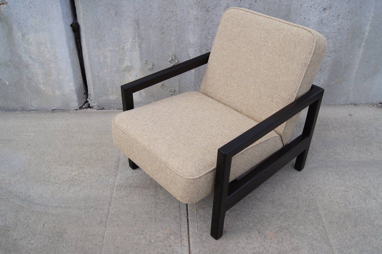 Designed by George Nelson for Herman Miller, this rare armchair, model 4774, features an open ebonized birch frame. Its strong rectangular lines contrast with the angled cushioning of the seat and back. The chair has been expertly refinished and