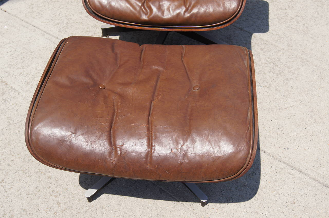 Early Production Lounge Chair and Ottoman by Eames for Herman Miller For Sale