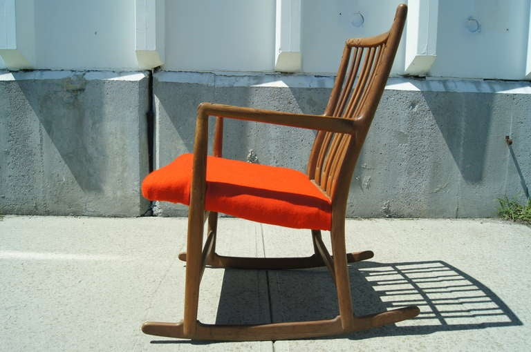 Hans Wegner designed this oak rocking chair, model ML-33, for Mikael Laursen in the 1940s. The rare rocker, the first that Wegner designed, showcases his elegant approach to modern design, with Danish tradition suggested by the carvings of leaves