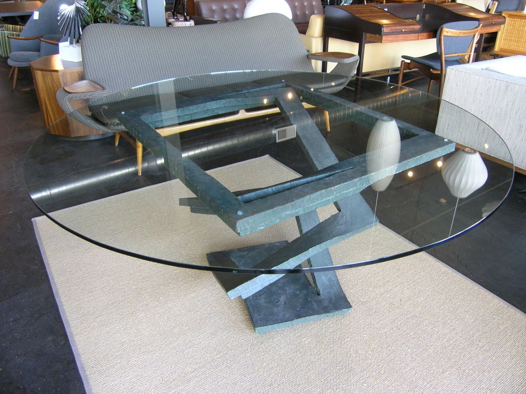 this fabulous table is constructed of piece of metal which has been cut and bent and