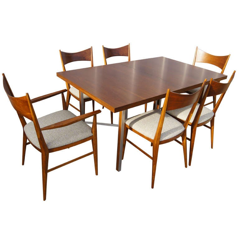 group walnut dining table and six chairs by paul mccobb for calvin