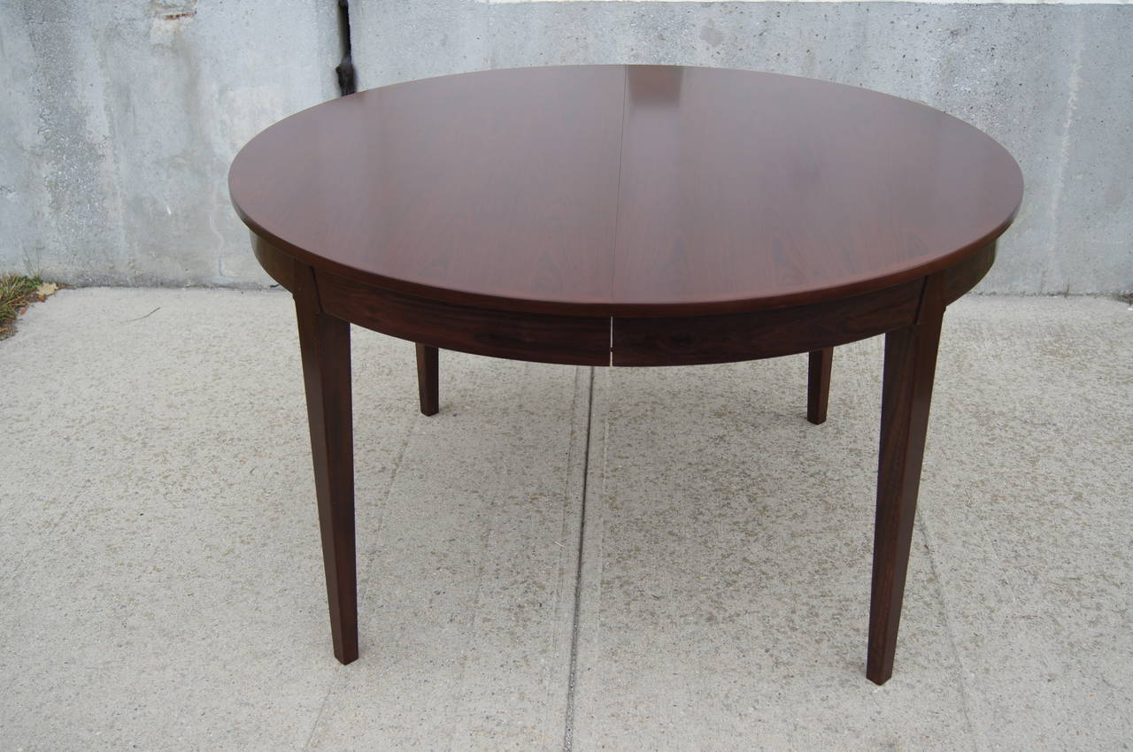 This Round Dining Table Was Designed By Arne Vodder. It Is Constructed Of  Rosewood And