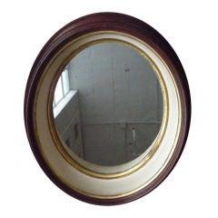 Oval walnut mirror