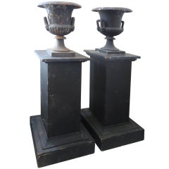 Pair of Black Iron Urns on Pedestals