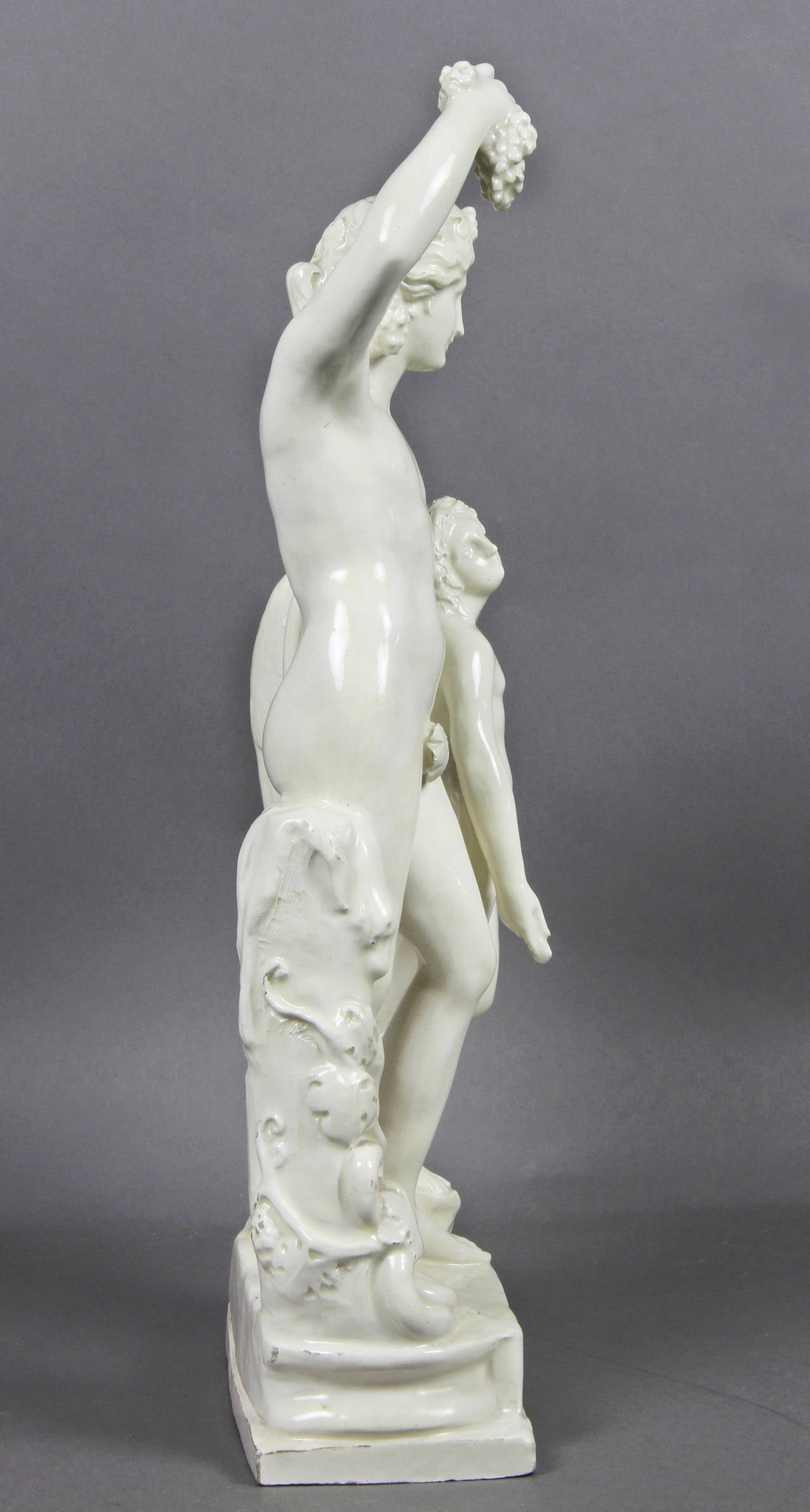 19th Century Creamware Figure of Bacchus with a Winged Boy For Sale