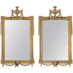 Pair of George III Adams Style Giltwood Mirrors