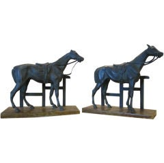 A pair of bronzed metal horse bookends