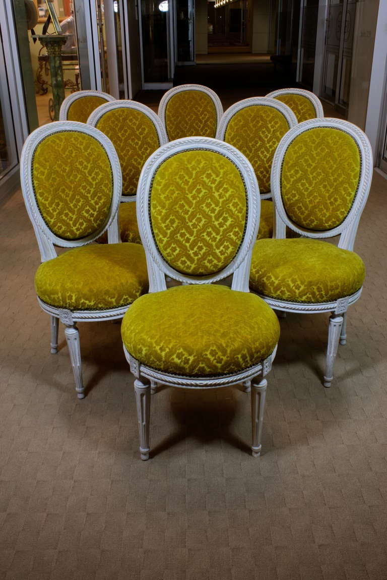 A lovely set of French grey-painted Louis XVI period side chairs, with nicely-carved rope detailing, cabriolet back and cable-fluted legs, (circa late 18th century.) Chairs have retained their vintage patterned wool mohair upholstery with brass